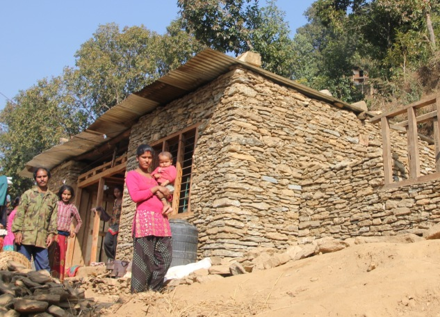 Uttam's family recently moved their shelter tin on to this new permanent house.