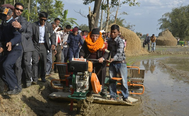 Prime Minister Pushpa Kamal Dahal plants rice in a field using a modern tractor during the inauguration of the Super Zone programme under the Agriculture Modernisation project, in Baniyani VDC of Jhapa district, on Tuesday, January 3, 2017. Photo: PM Secretariat