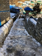 It's steep alleyways were nevertheless caked in layers of hardened Februrary ice